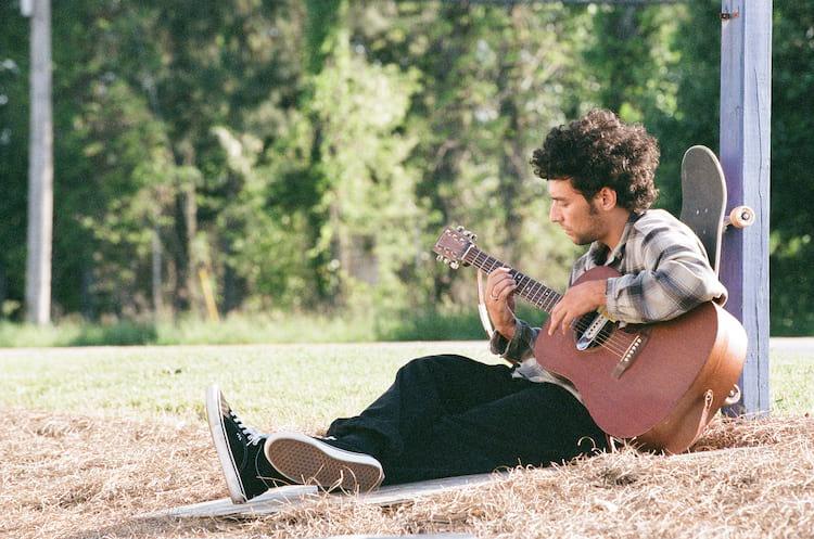 Glick Playing Guitar